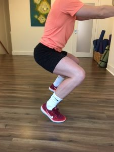 exercises for avoiding skiing injuries - Squat hold on tiptoes