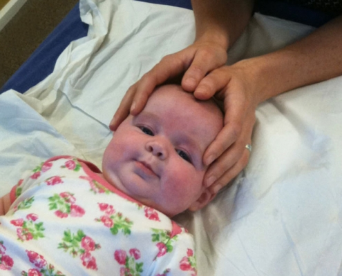 Baby taking part in paediatric osteopathy